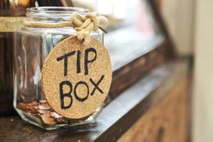 A tip jar full of money