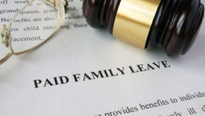 Paid family leave paper and a gavel